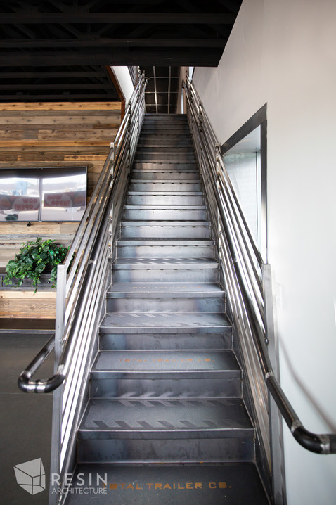 Custom made metal staircase inside Total Trailer Co. in Idaho Falls.
