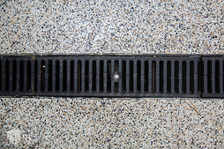 Detail shot of the floor drainage system of the detail and repair bays inside Elite Auto Sales in Idaho Falls.