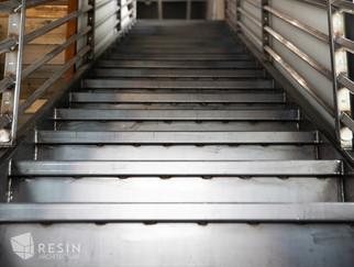 Custom made metal staircase inside Total Trailer Co. in Idaho Falls.