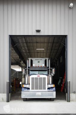 Open bay door with semi truck inside of Total Trailer Co. in Idaho Falls.