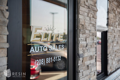 Image of the Elite Auto Sales in Idaho Falls logo on the front door.