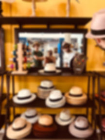 3 people trying on panama hats in key west