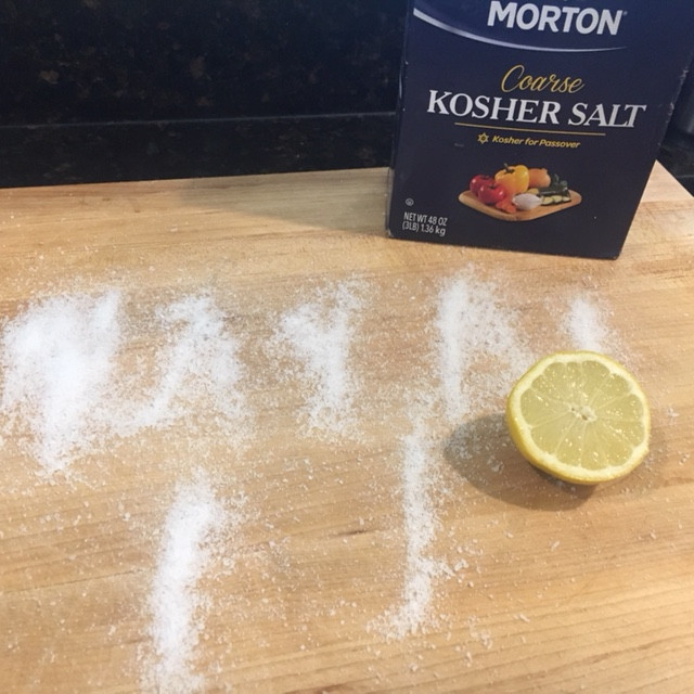 odor removal with Kosher salt on a cutting board