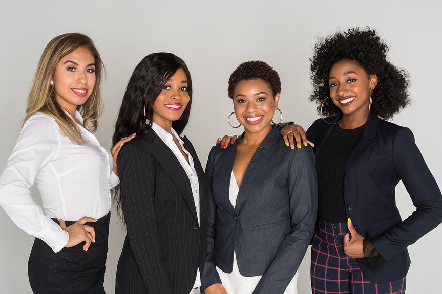 Group of four minority businesswomen wor