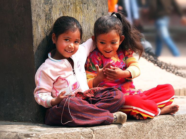 Kids sitting on the street of Kathmandu