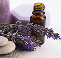 essential-oil-bottle-with-lavender-candl