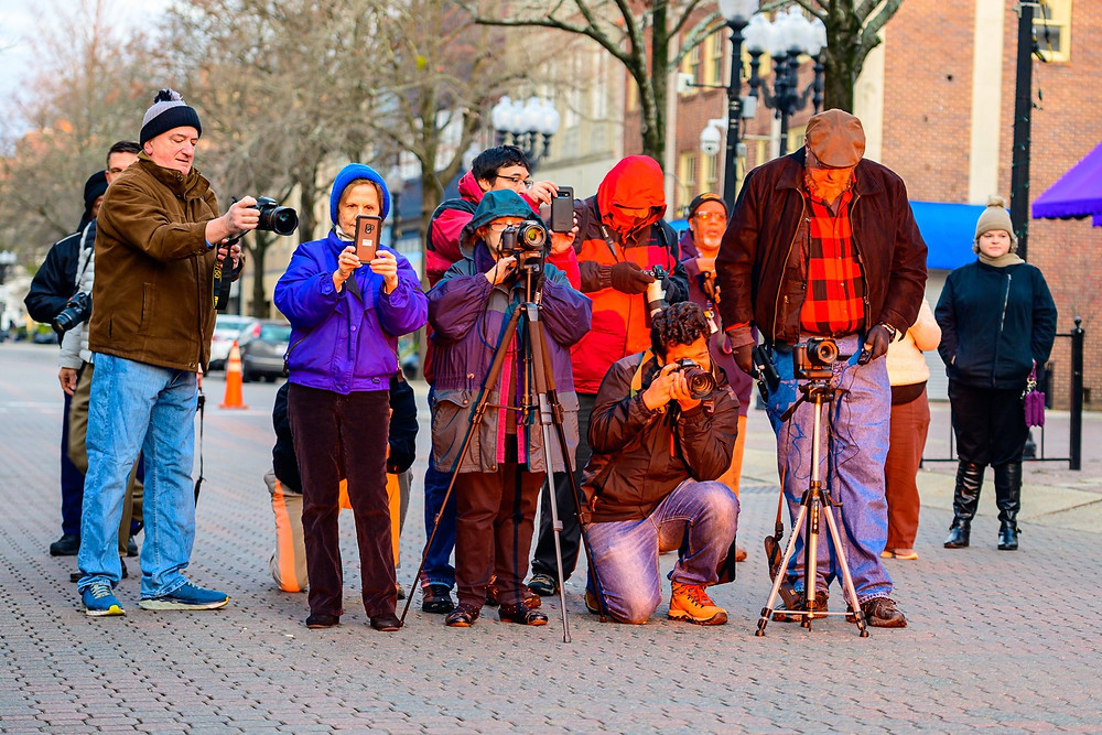 Despite cold temperatures, hardy photographers greeted the sunrise thru the Fayeteville Market House arches yesterday morning.  As you can see, cameras don't define the photographer. I saw everything from mirrorless to mobile. They all can take great images.  The next day the sun will be in the same position is November 11.