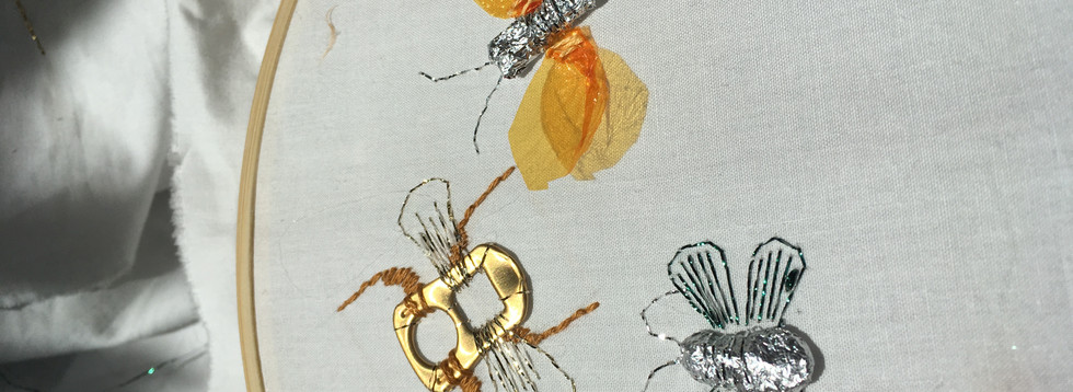 Hand embroidered bugs using up-cycled materials