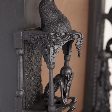 Frame detail: skeleton and raven