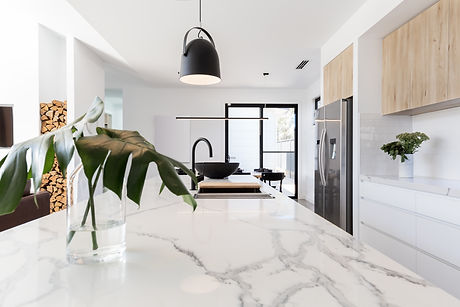Kitchen marble bench close up with black