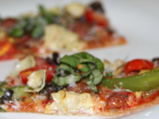 Fresh Basil-Oregano Pizza with Sausage, Olives, Peppers & Artichokes