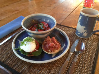 Poached Egg on an English Muffin and Strawberries & Yogurt with fresh Basil