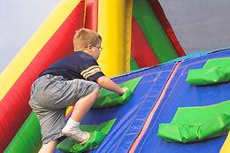 boy climbing bounce house.jpg
