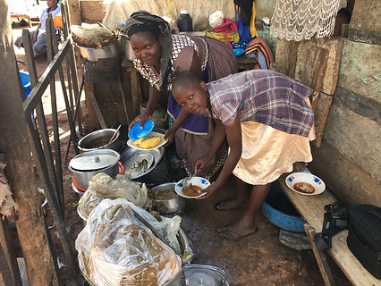Ugandan Women Cooking a Meal