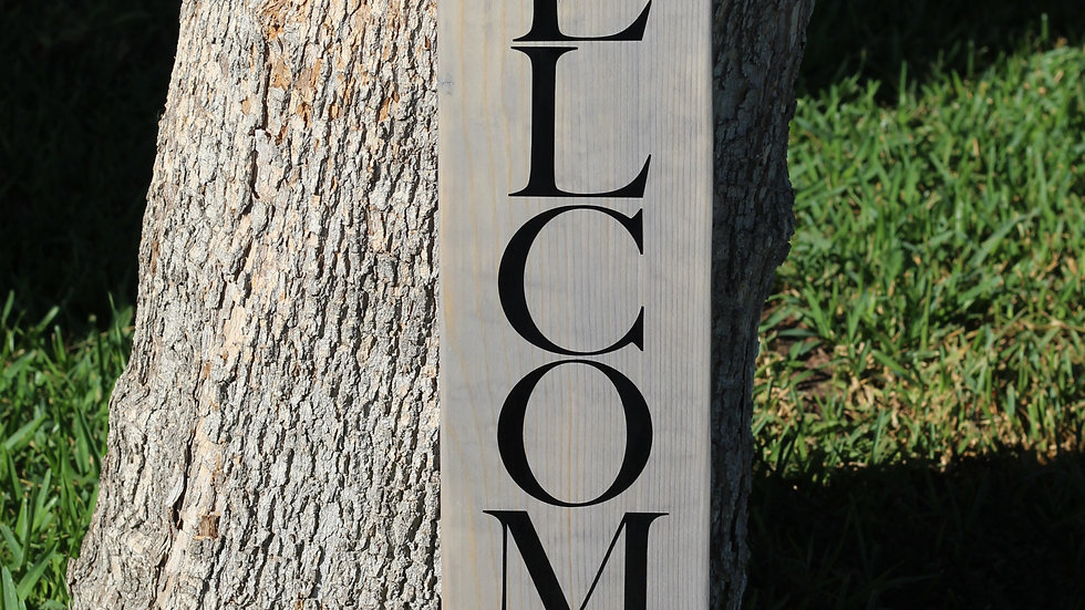 Weathered Gray and Black Welcome Sign