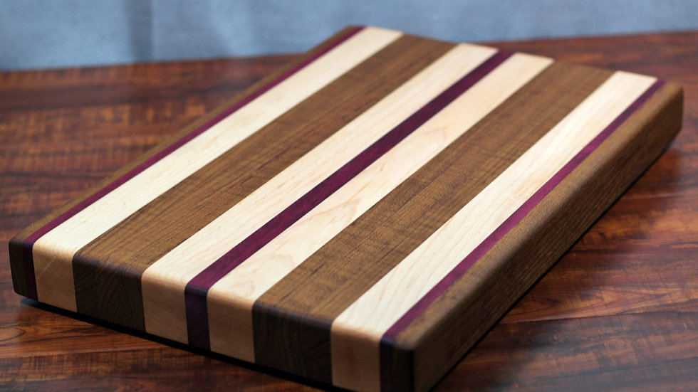 Teak, Maple, and Purple Heart Edge Grain Cutting Board