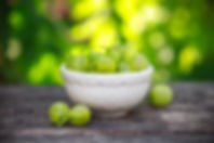 small bowl of Ripe gooseberries on a woo