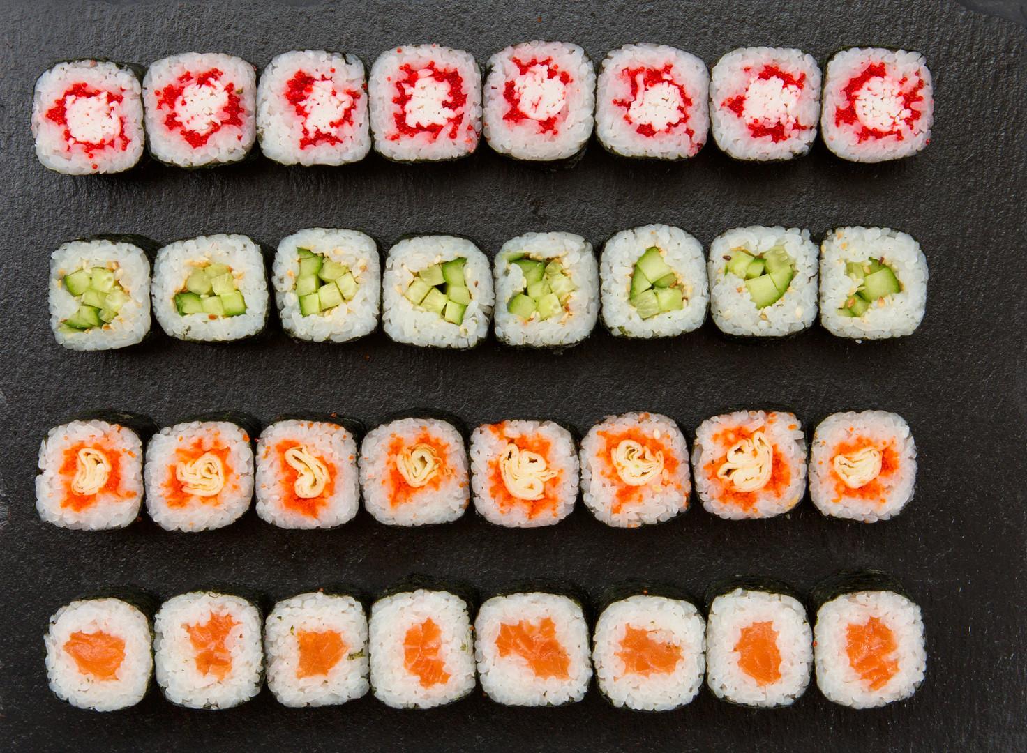 Big set of sushi roll on slate. Japanese
