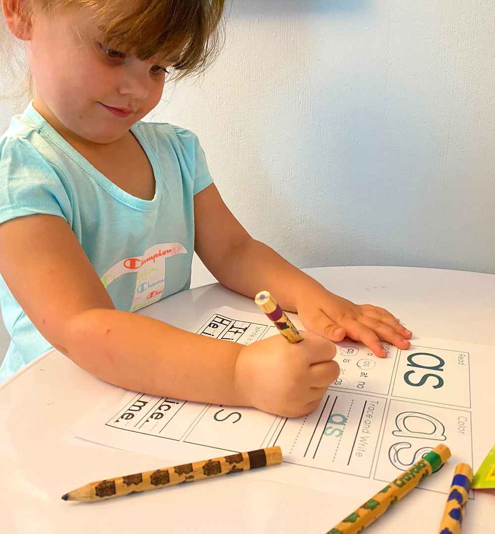 Autistic Child using thick colored pencils to write