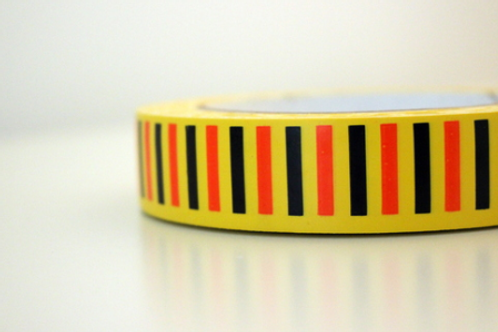 Yellow tape - black & orange vertical stripes