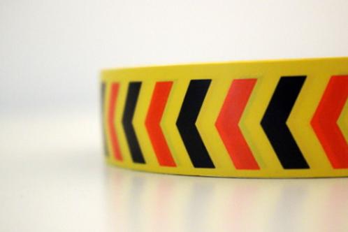 Yellow tape - black & orange arrows
