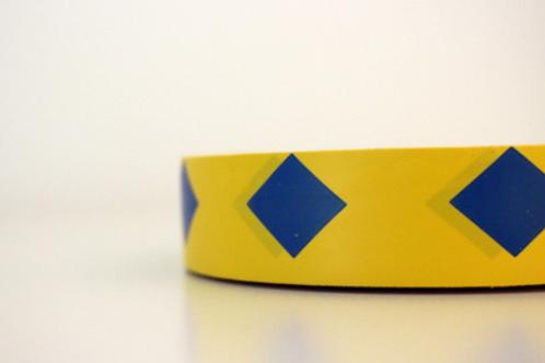 Yellow tape - blue diamonds