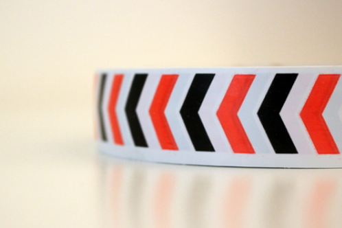 White tape - black & orange arrows