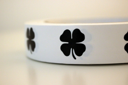 White tape - black clovers