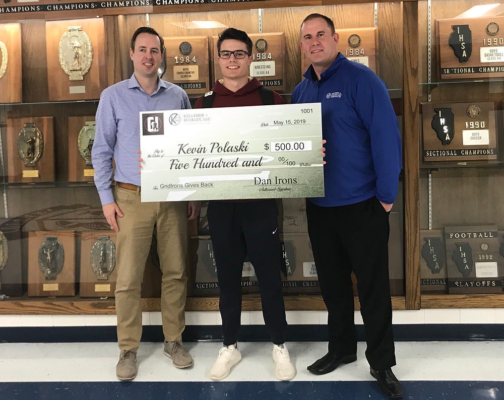 Bob Holland (left) of Kelleher & Buckley and Dan Irons (right) of GridIrons present Kevin Polaski with the scholarship award