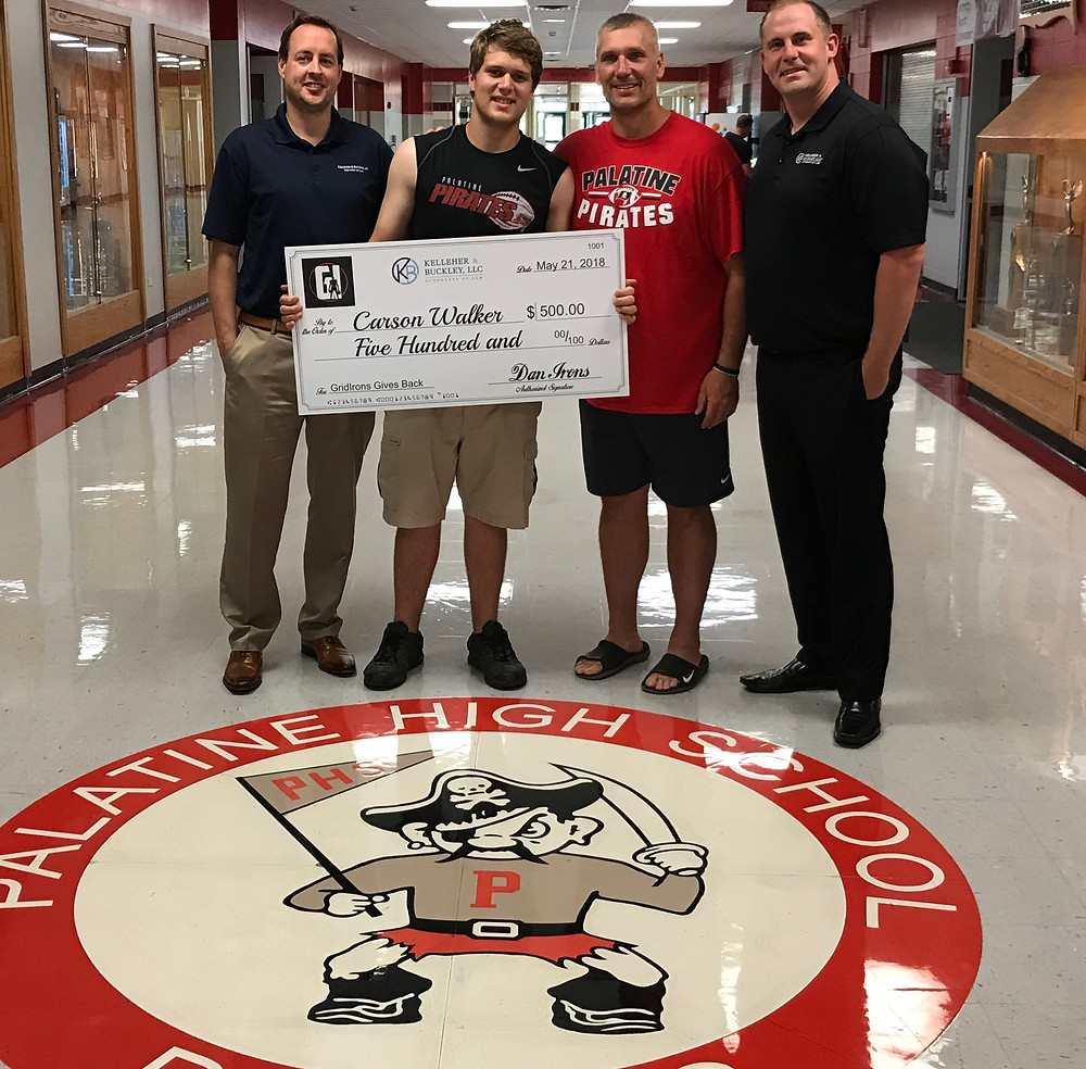 Carson Walker accepts the Gridirons Gives Back award with Coach Olson and presented Robert Holland of Kelleher & Buckley and Dan Irons of GridIrons.