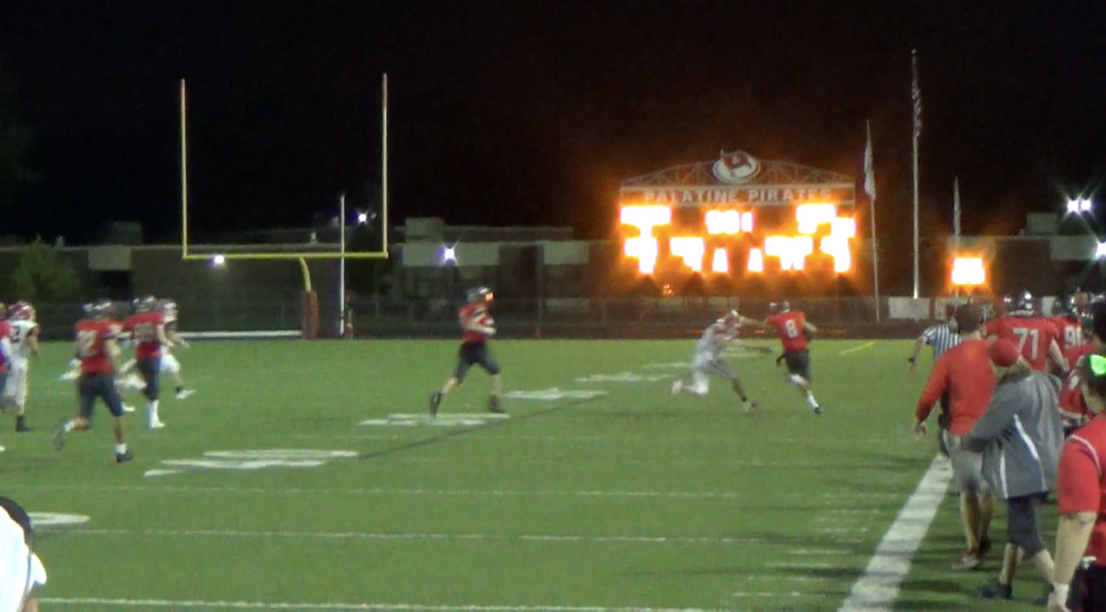 Jake Moertl trucks down the sideline after his third quarter interception led to a 14-14 tie on Friday night.
