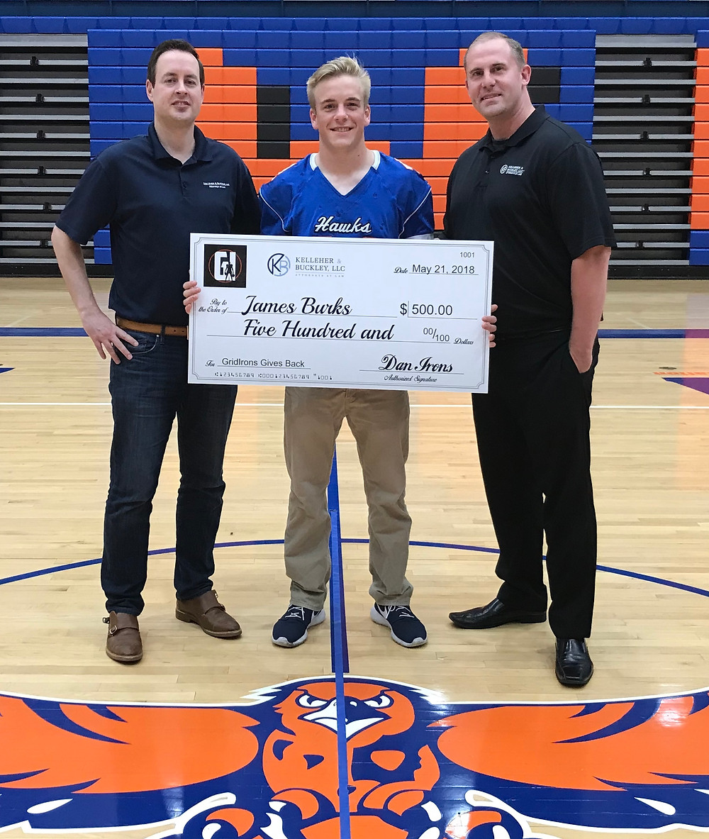 Kelleher & Buckley's Bob Holland and GridIrons' Dan Irons present James Burks with a scholarship at Hoffman Estates high school.