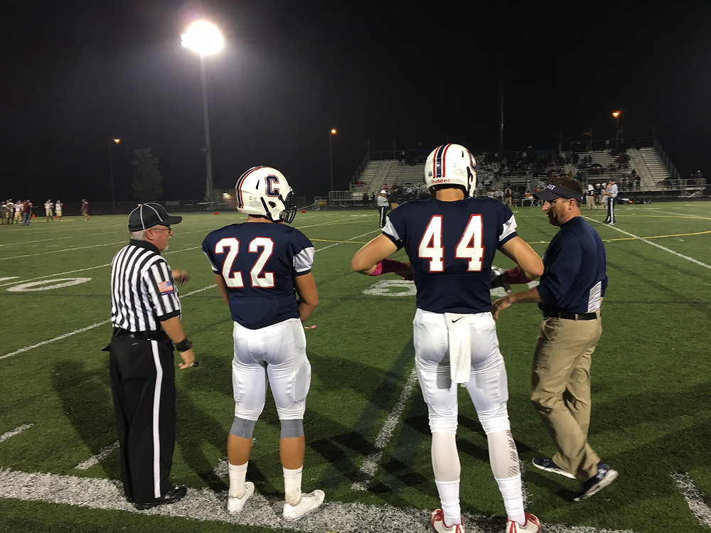 Jack Reiger and Mason Sykes get ready for the coin toss Friday night against Schaumburg.