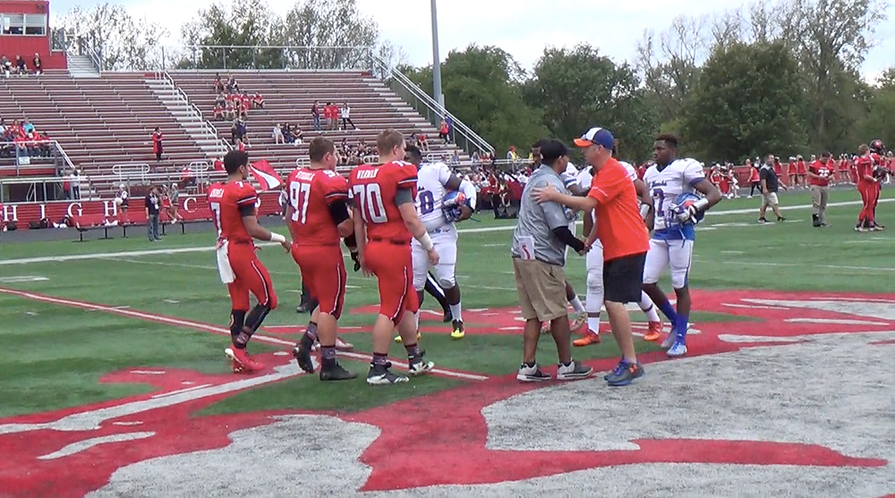 Coaches and players shake hands before kickoff o Saturday in Barrington