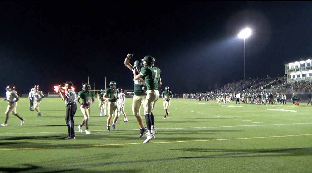 Ben Konopka celebrates with teammates after scoring in the second quarter on Friday night in Palatine.