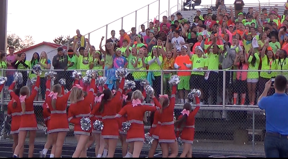 The Palatine cheerleaders get the student section fired up during the Broncos/Pirates game Thursday night in Palatine.