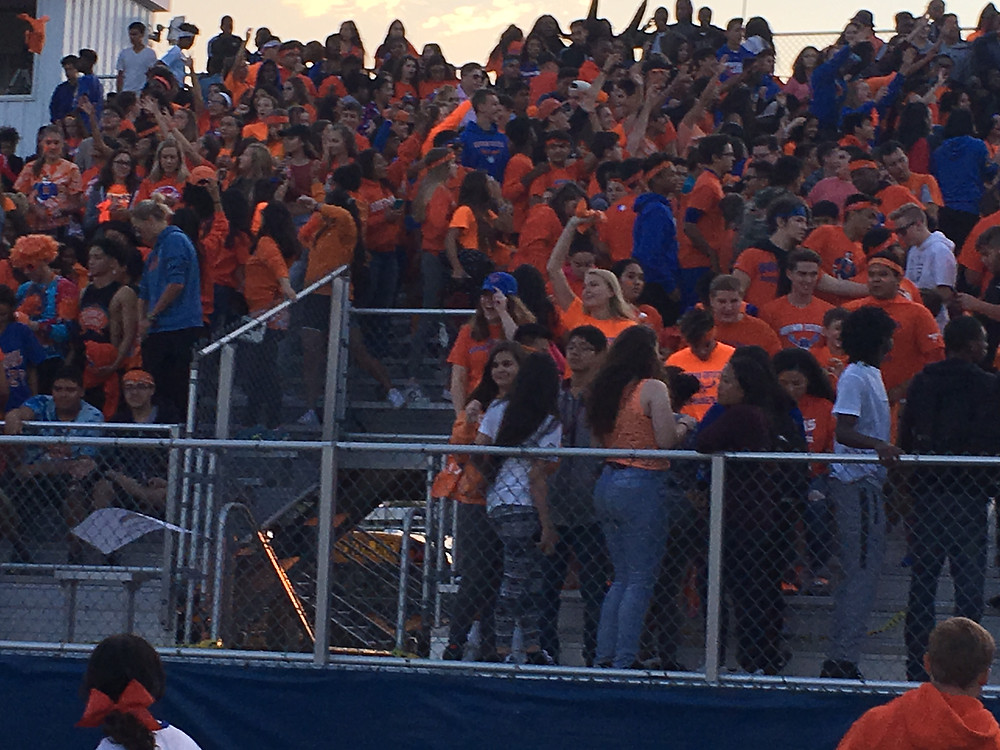 The Blue Crew cheers on the Hawks on Friday Night