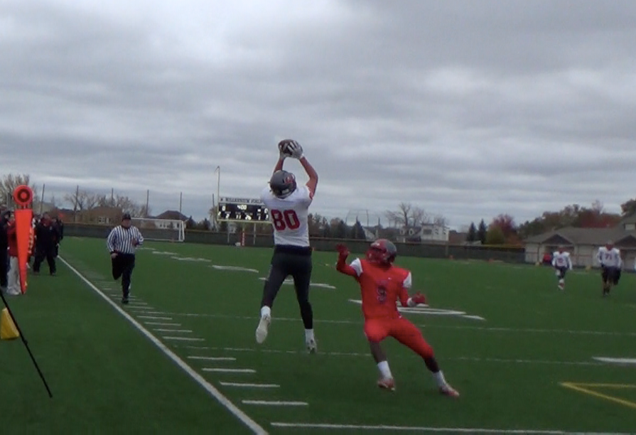 Johnny O'Shea makes a great leaping grab against South Elgin on Saturday.