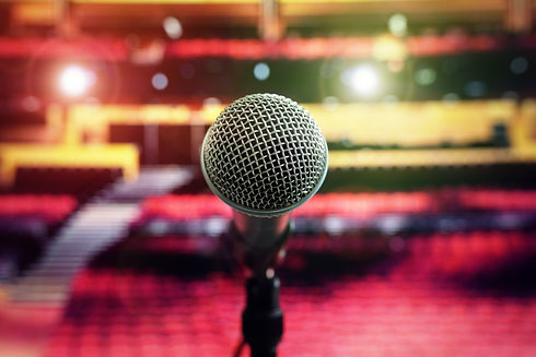 microphone-on-stage-in-concert-hall-thea