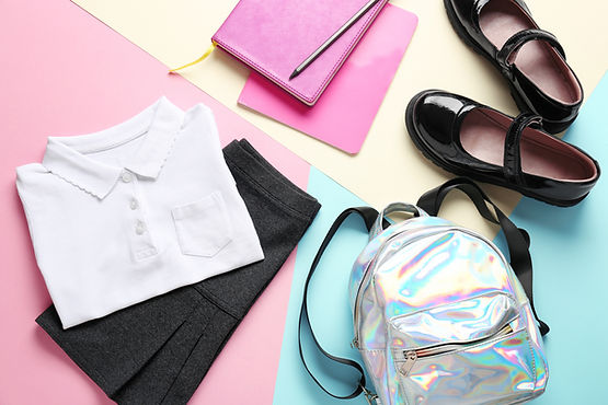 Stylish school uniform with backpack and stationery on color background.jpg