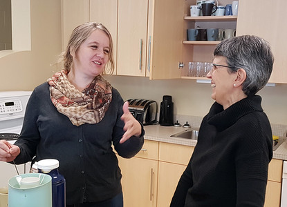 Sieglinde Toews (left) visits with Nicole Duerksen (Spanish ministry) during coffee break.