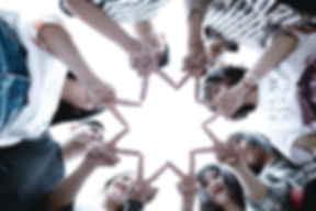group-of-people-forming-star-using-their-hands-1116302_edited.jpg