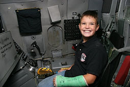 Joe as child in cockpit.jpg
