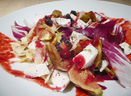 Baked figs with radicchio and goats cheese salad and a blackberry balsamic dressing