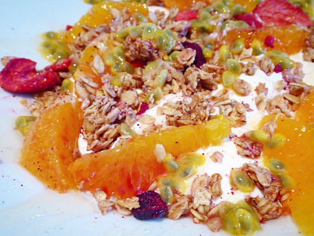 Breakfast bowl with orange, passion fruit and granola