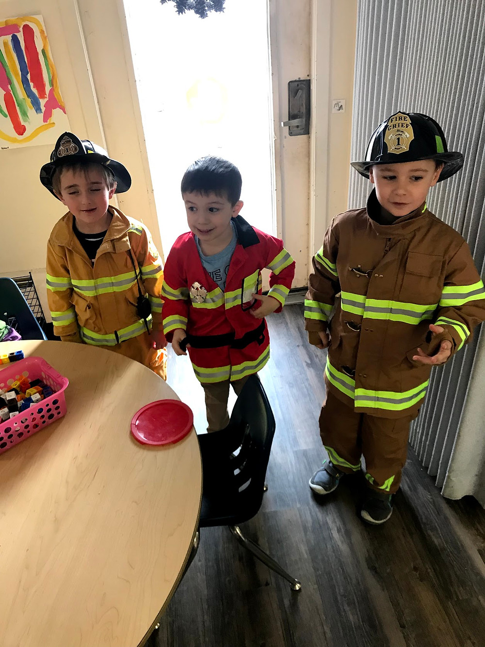 students from gen ed and EI play firefighter