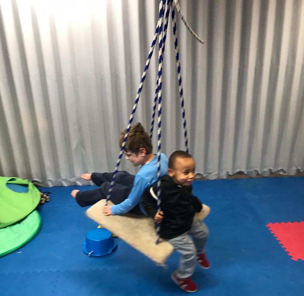 two students use gross motor room