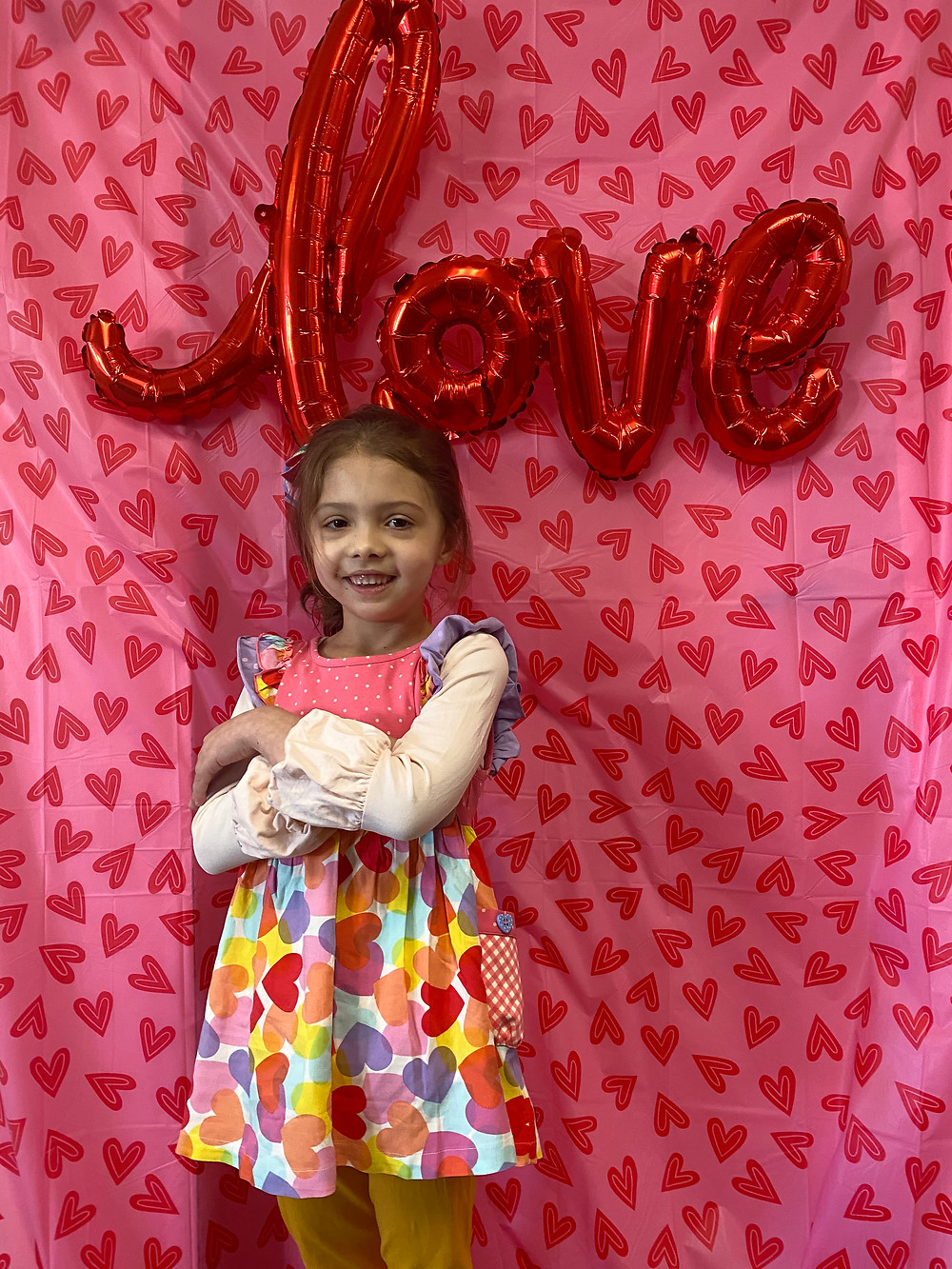 preschool student poses for Valentine's picture