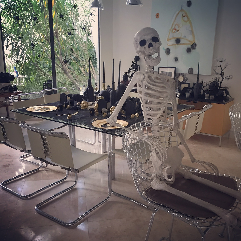 skeletons and modern decor for halloween. chic modern decor. dining table decor, tablescape, interior design of houston, spooky designs. happy halloween