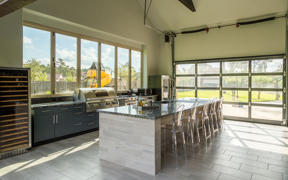 By Design Interiors - Interior Designers in Houston -indoor outdoor living and kitchen